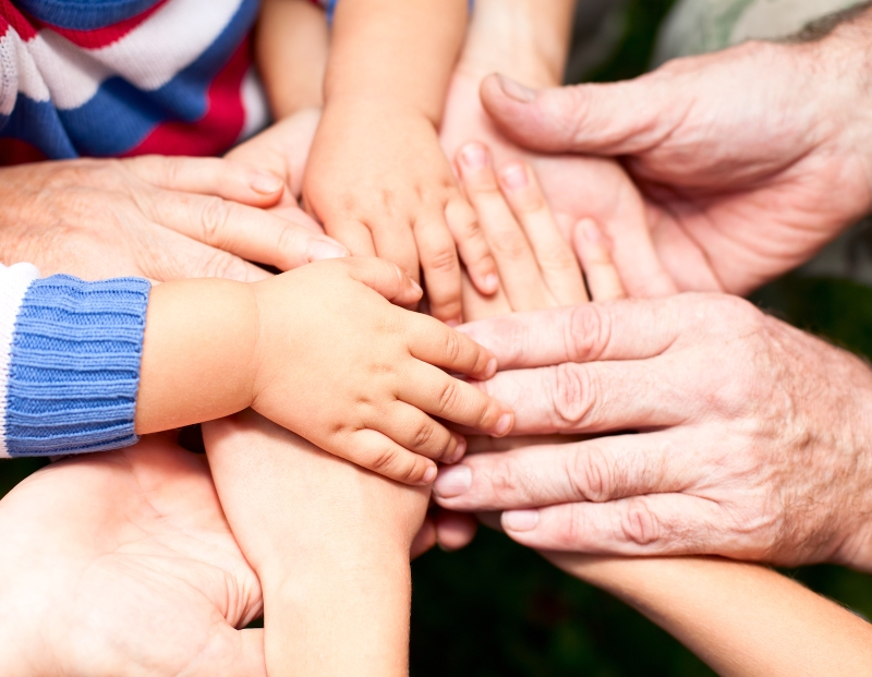bigstock-Family-holding-hands-together-33759587